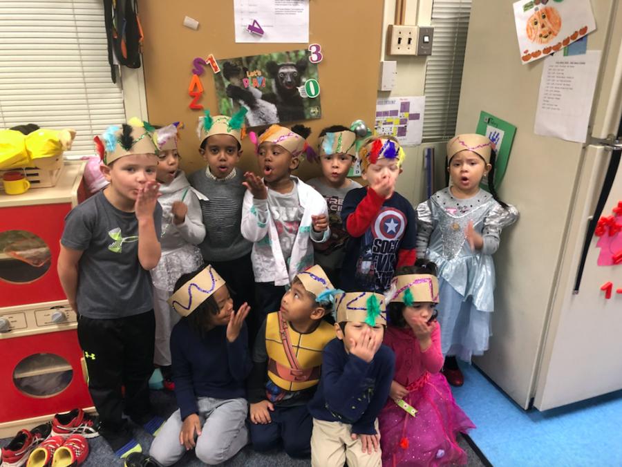 Photo of preschool students wearing headdresses.