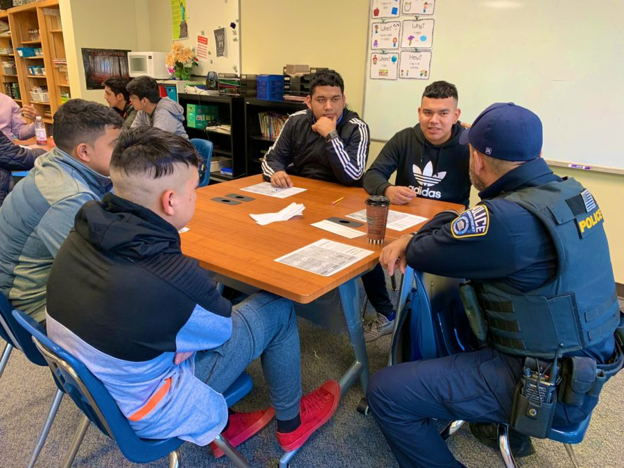 EL Institute students meet with an ACPD officer.