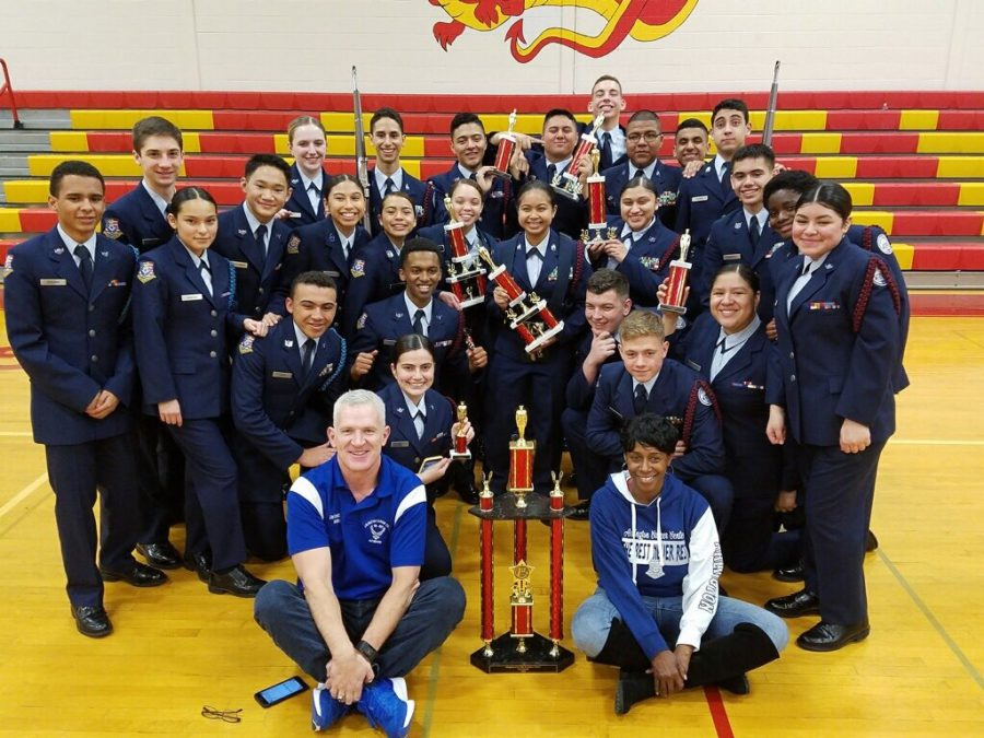 AF JROTC Drill Team poses with their trophy