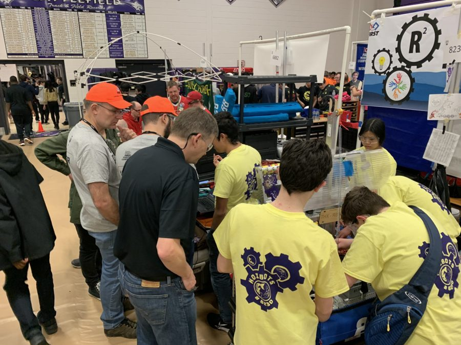 ACC Koibots working on their robot