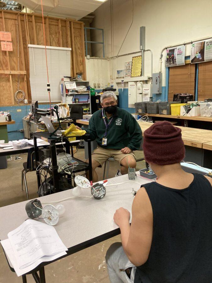 Mr. Sanchez presents content during Electricity class.