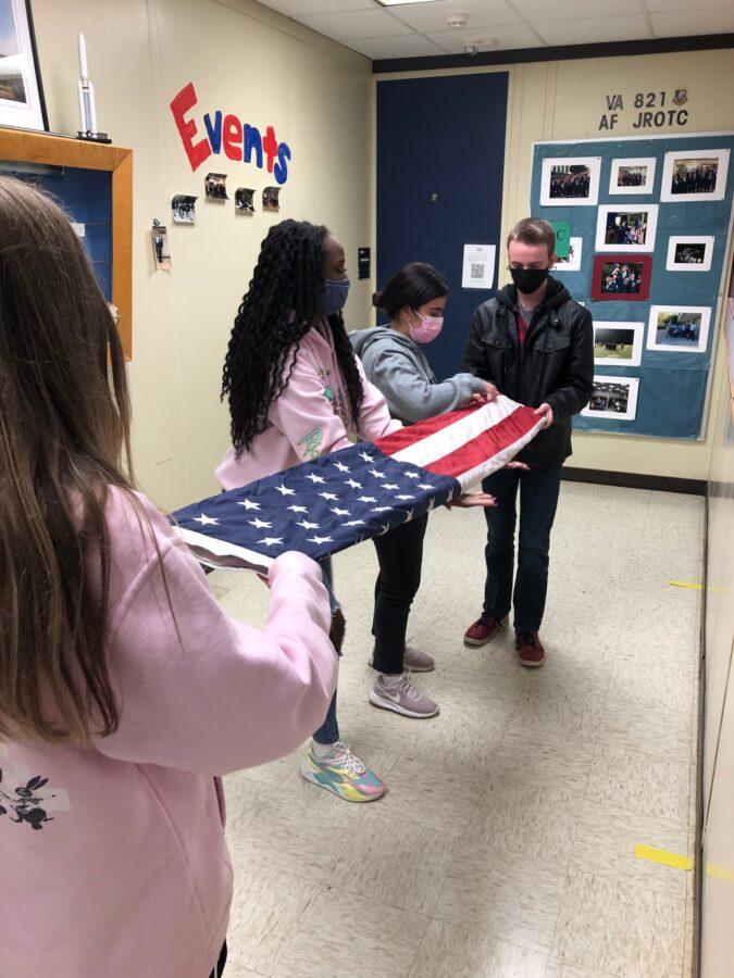 AF-JROTC students prepare the flag for the flag pole.