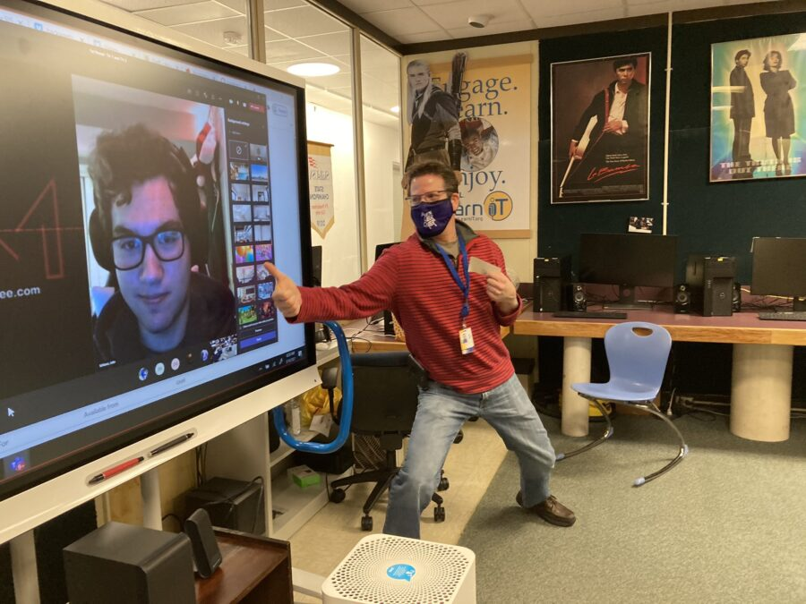Mr. O'Day poses with a virtual student on the SMART Board.