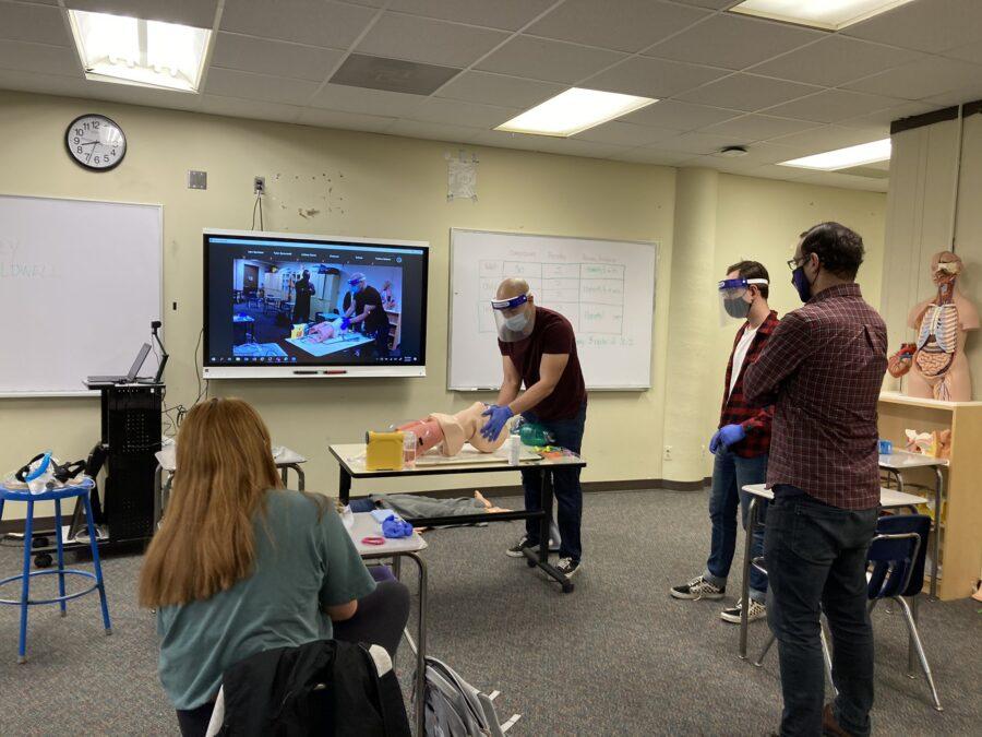 EMT students observe during skills instruction.