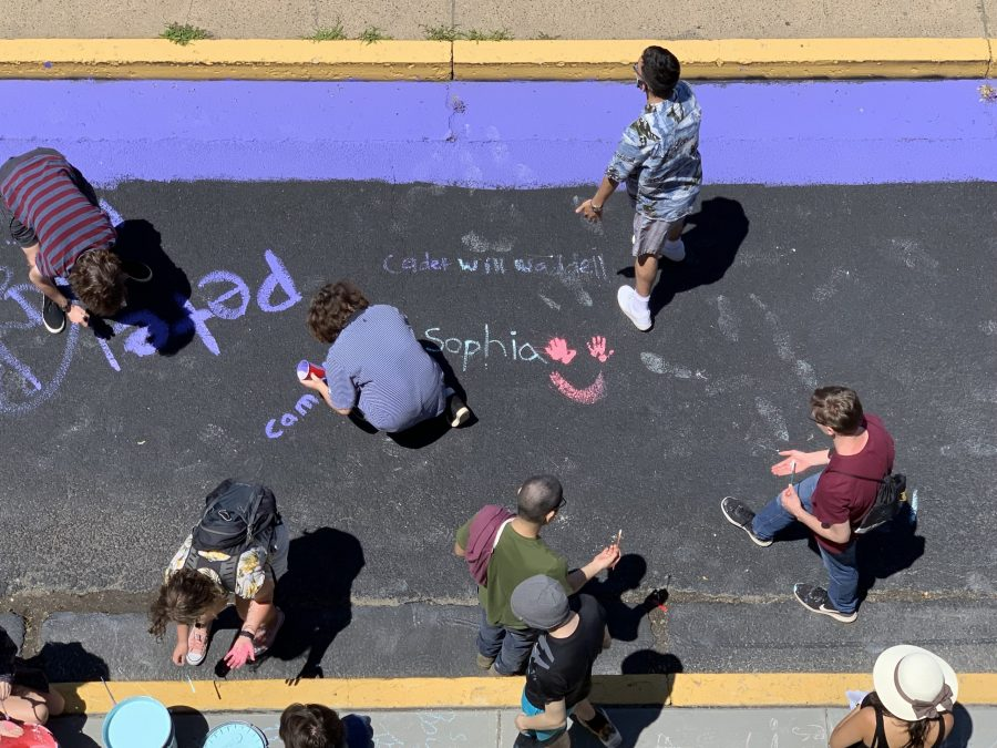 Students add names to mural