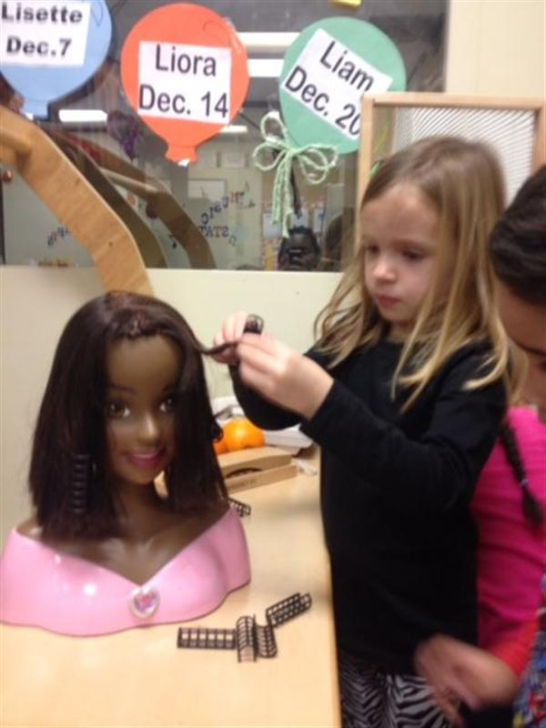 Preschool student learns about Cosmetology