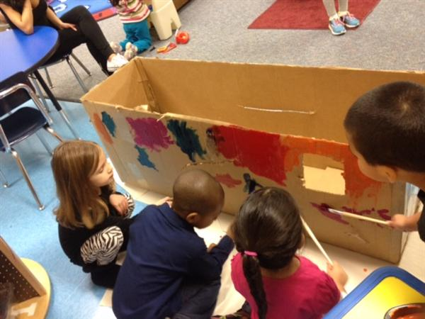Preschool students build car out of boxes